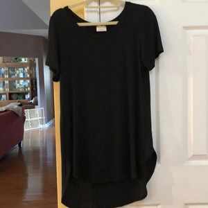 Black Rayon/Spandex hi-lo tee. Large. New with tag